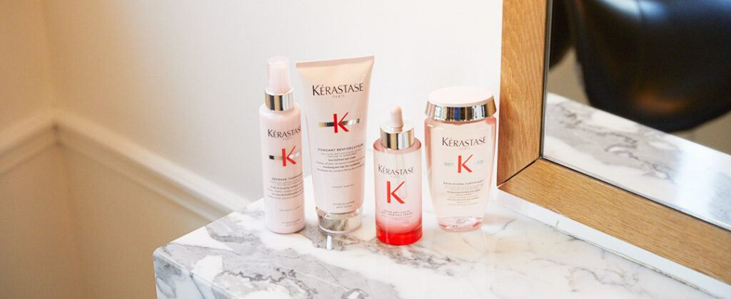 kerastase products on marbled surface