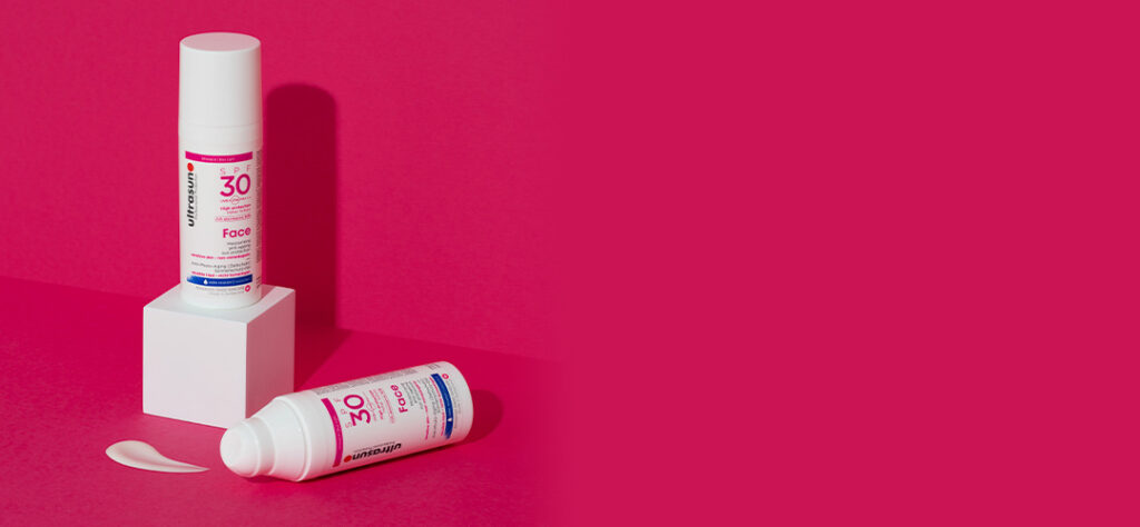 ultrasun formula for sun protection with skincare benefits on red background