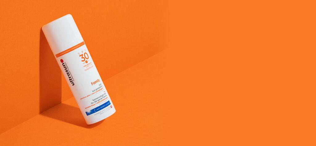 ultrasun sun cream on orange background
